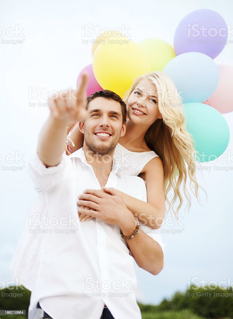 couple with colorful balloons at sea side royalty-free stock photo