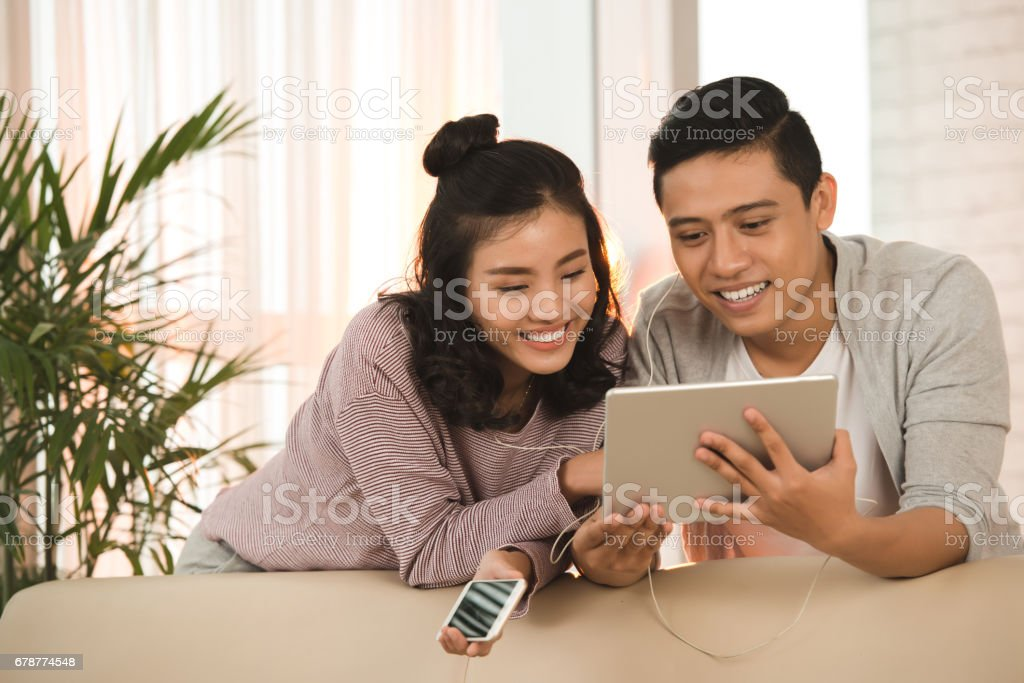 Couple with digital tablet royalty-free stock photo