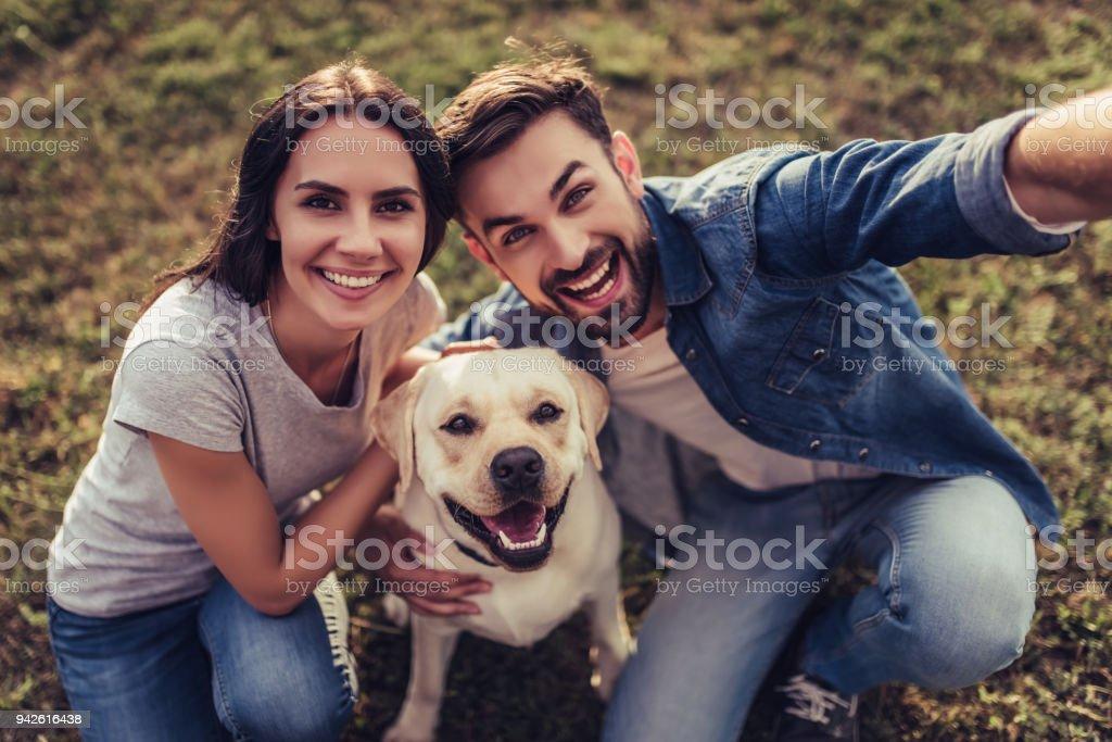 Couple with dog stock photo