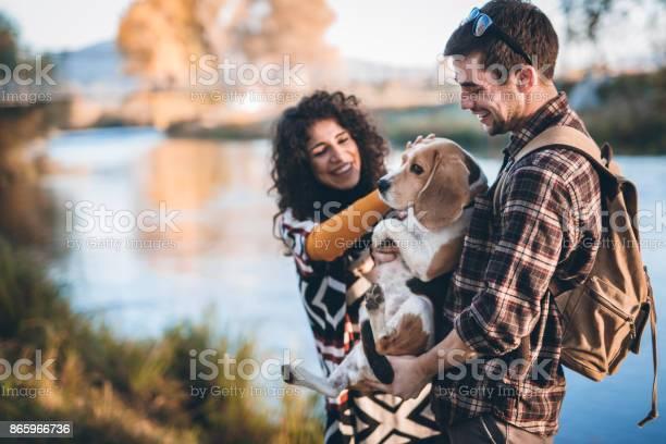 Couple with dog walking by the river picture id865966736?b=1&k=6&m=865966736&s=612x612&h=d7in4xg1ojd0rbfftquoczlaxrcbigljl41fu iwmfs=