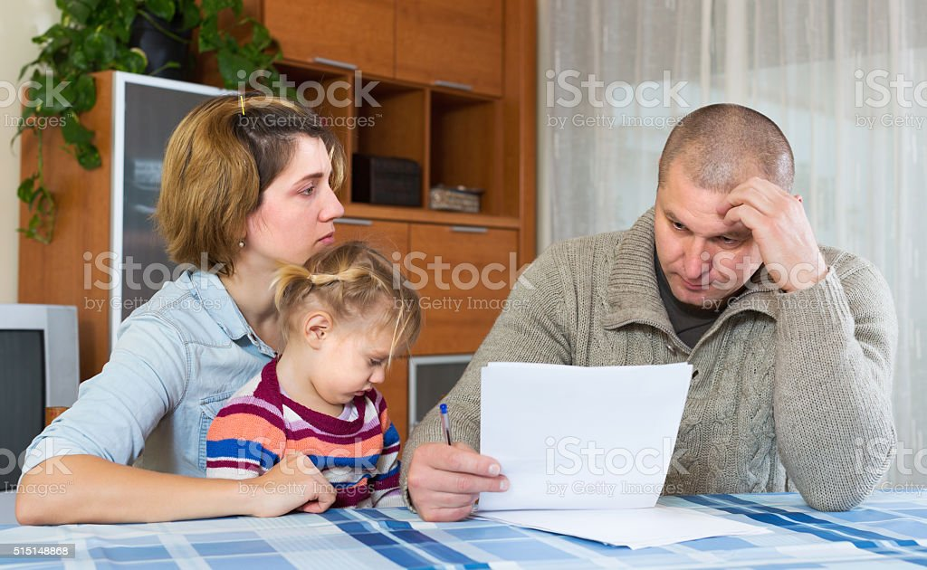 Couple with girl counting budget stock photo