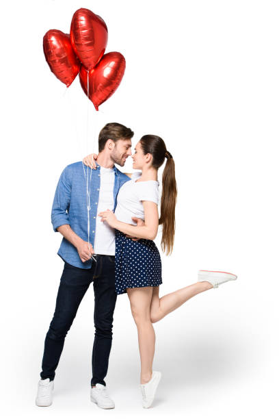 couple with heart shaped balloons - boyfriend stock photos and pictures