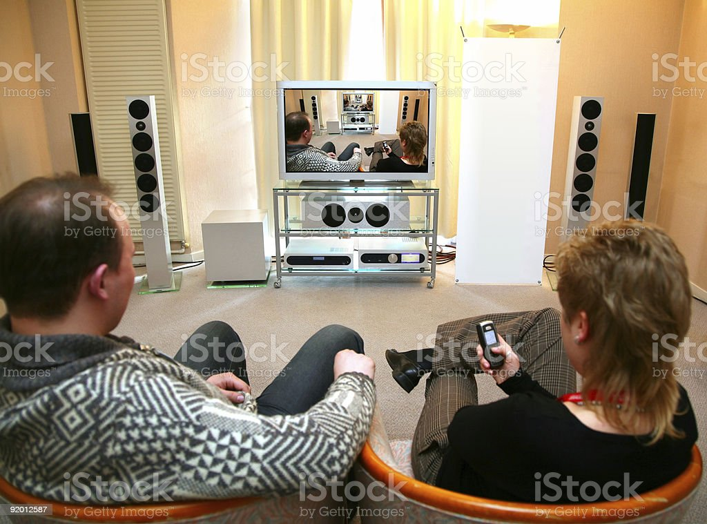 couple with home theater royalty-free stock photo