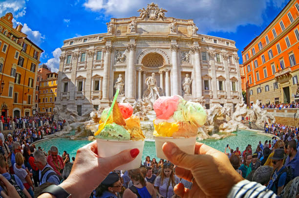 Couple with Italian beautiful bright  sweet ice - cream cone with different flavors . stock photo
