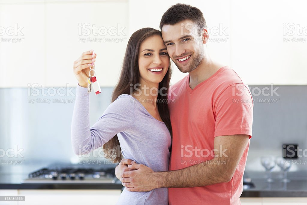 Couple with keys to new home stock photo