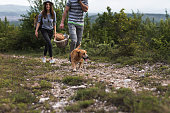 Couple with loving pet walking on nature