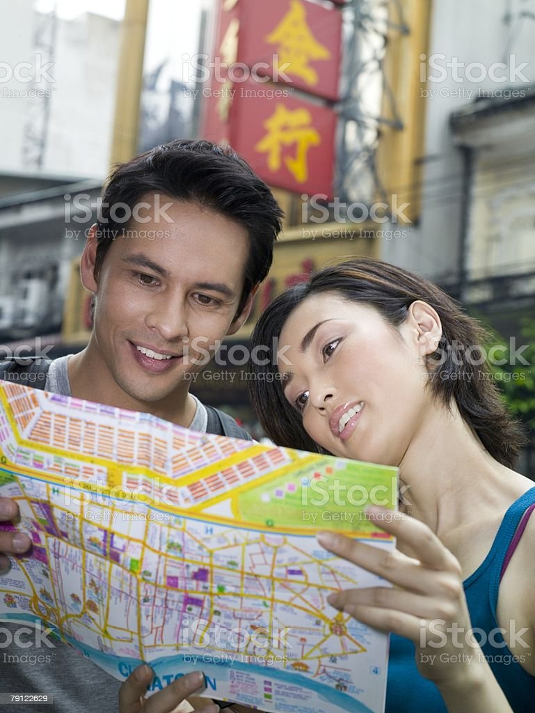 Couple with map royalty-free stock photo