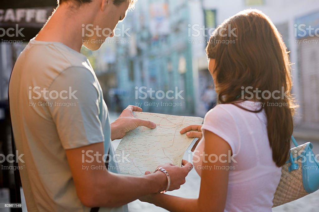 Couple with map royalty free stockfoto