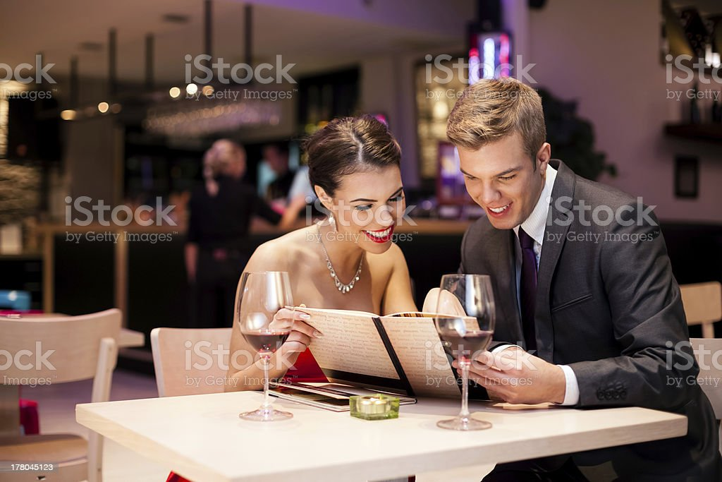 couple with menu card royalty-free stock photo