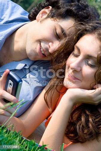 young couple communicating with mobile
