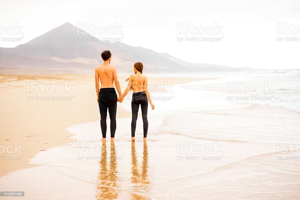 Couple With Naked Torso On The Beach Stock Photo  More Pictures Of Adult  Istock-9078