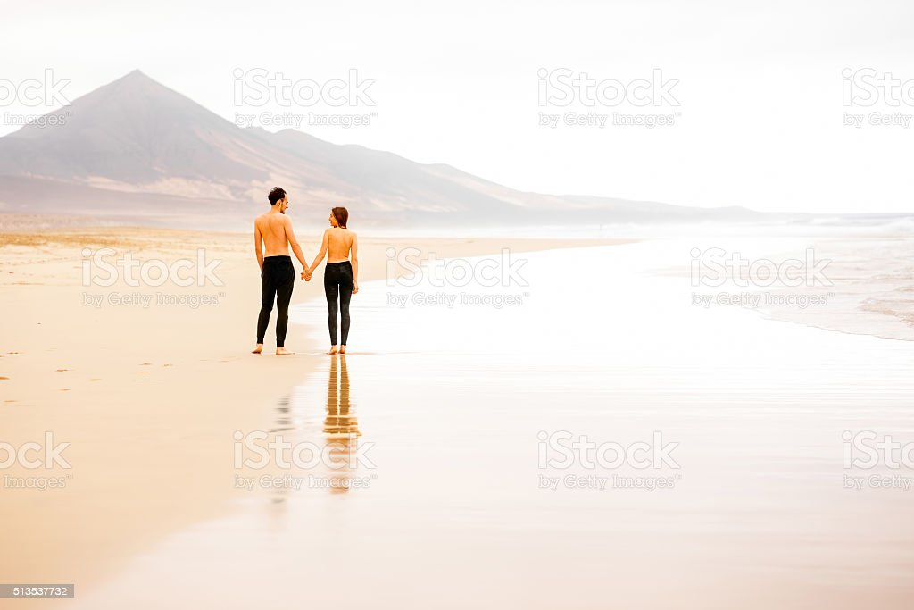 Couple With Naked Torso On The Beach Stock Photo