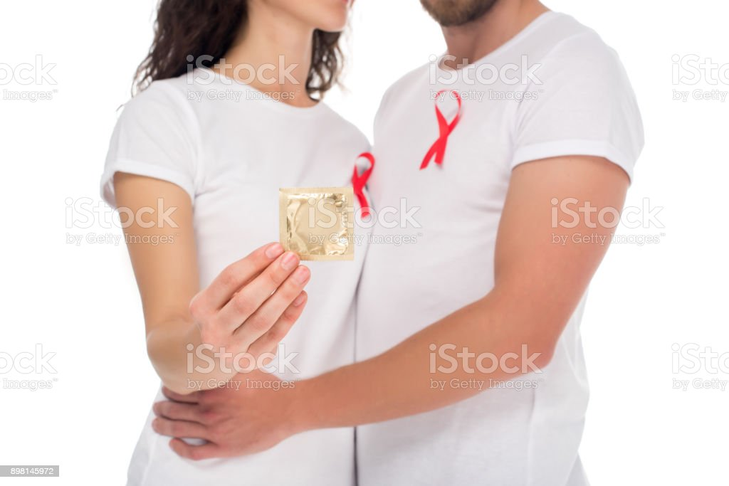 couple with packed condom stock photo