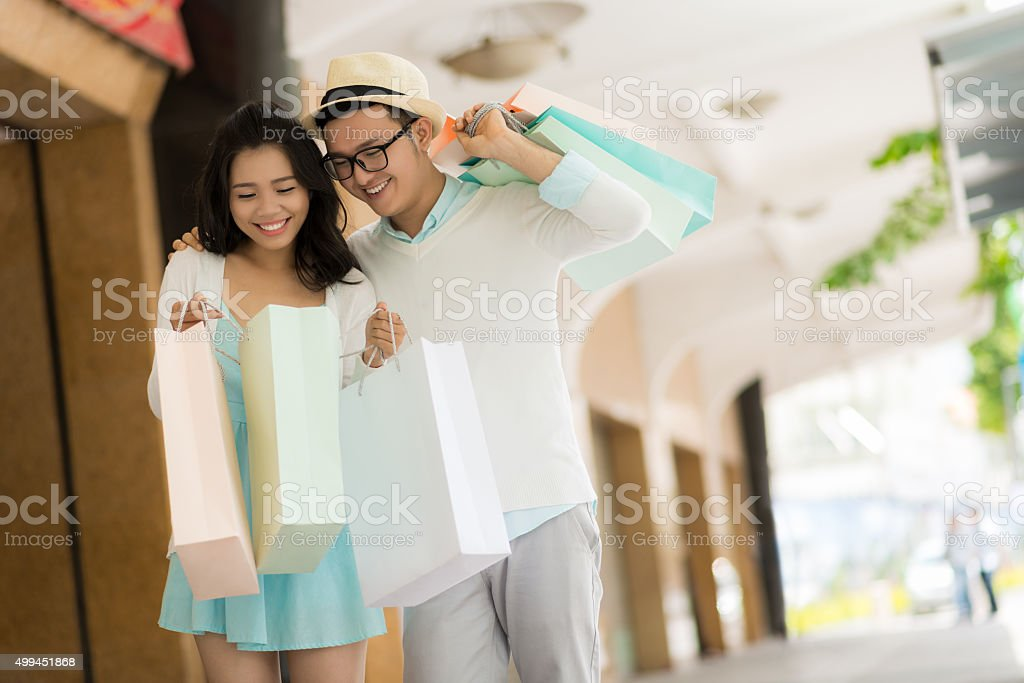 Couple with paper bags stock photo
