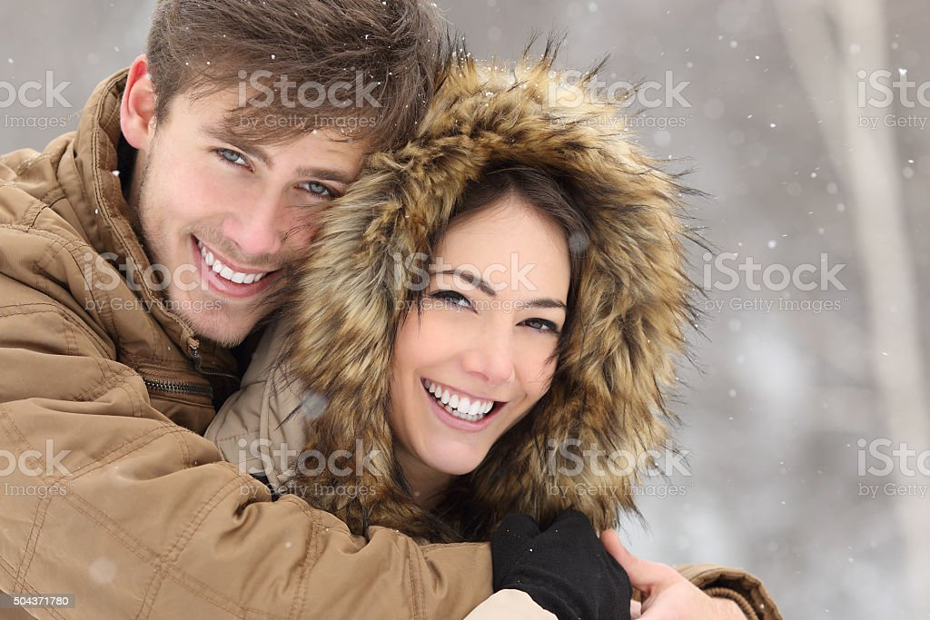 Couple with perfect teeth in winter stock photo