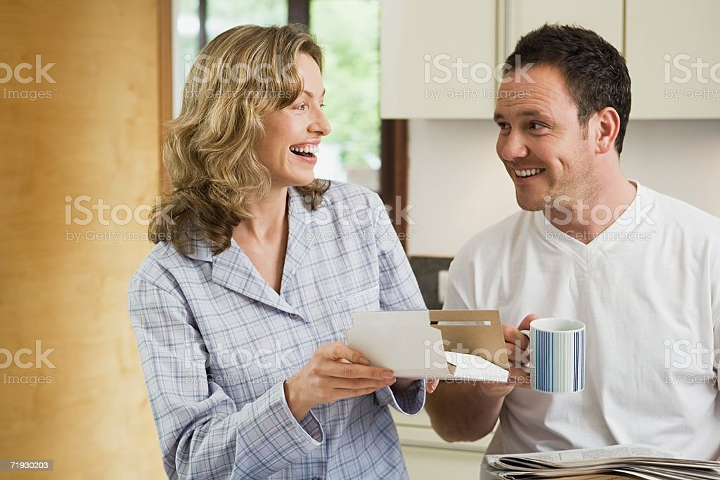 Couple with post in kitchen royalty-free stock photo