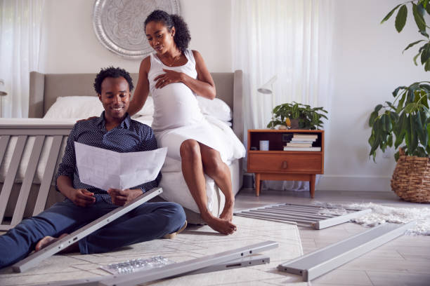 https://www.istockphoto.com/photo/couple-with-pregnant-woman-looking-at-instructions-for-self-assembly-baby-cot-gm1254542551-366712757