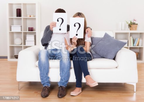 istock Couple with question marks 178571217