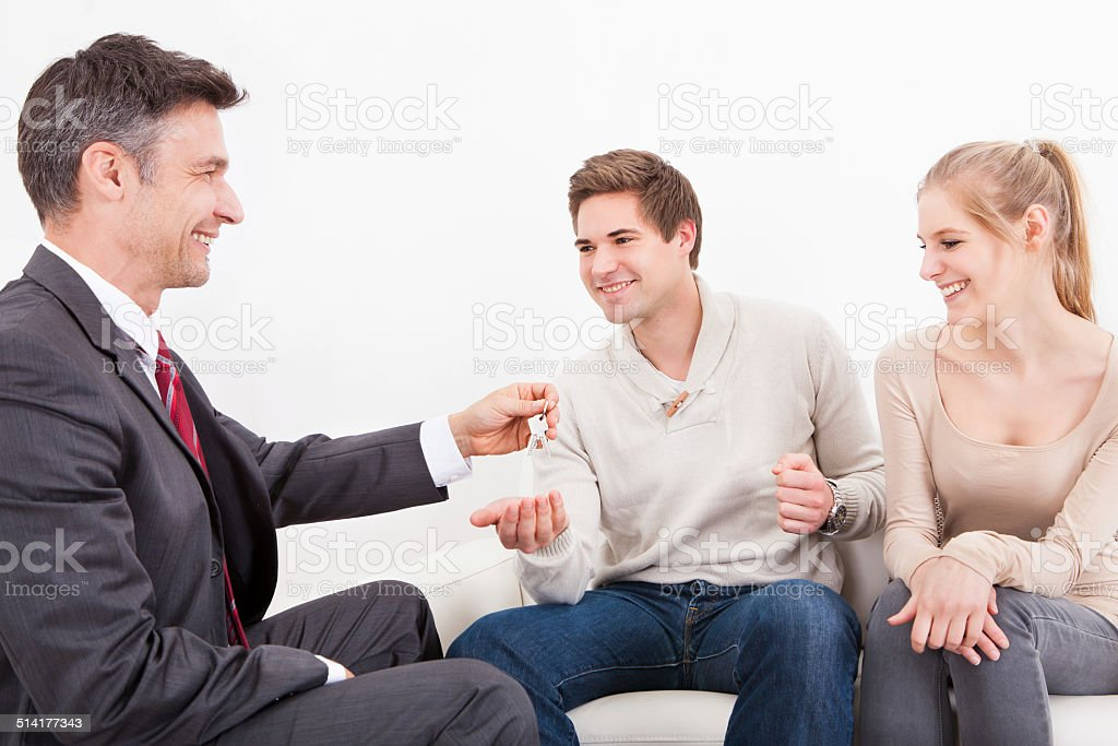 Couple With Real Estate Agent stock photo