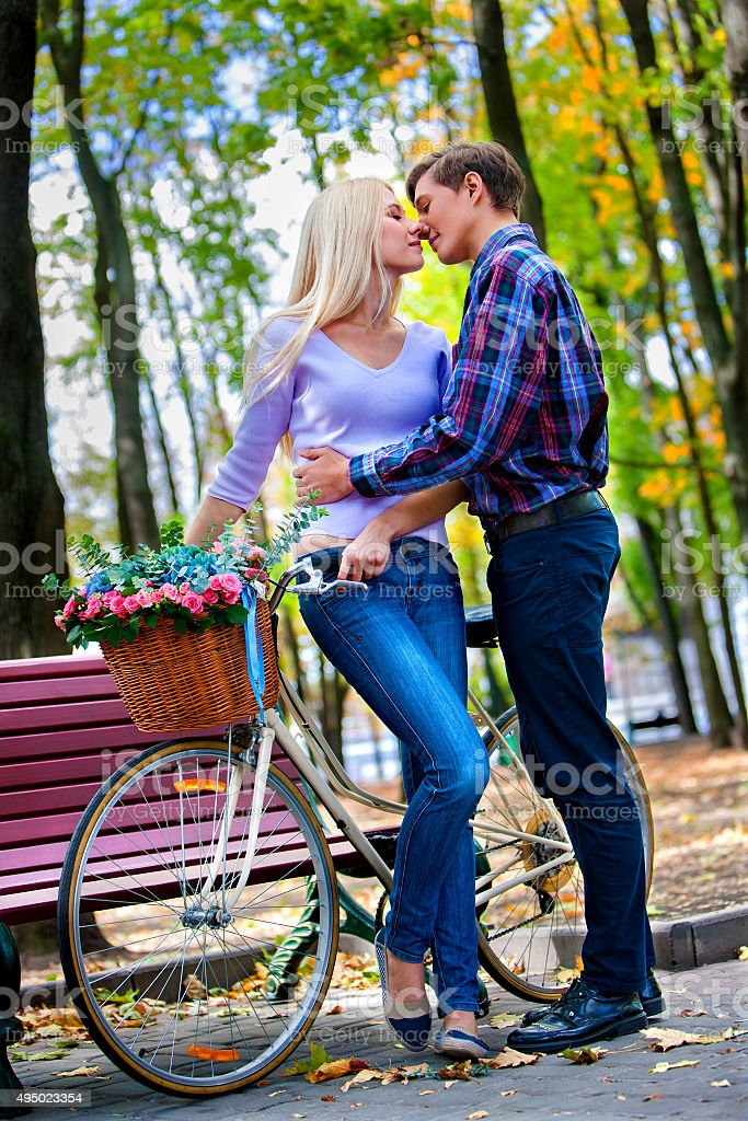 Couple With Retro Bike In The Park Stock Photo More Pictures Of