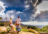 Couple on the cliff with retro bike.