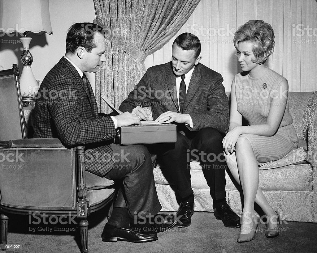 Couple with salesman royalty-free stock photo