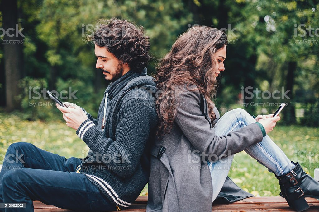 Couple with smart phones stock photo