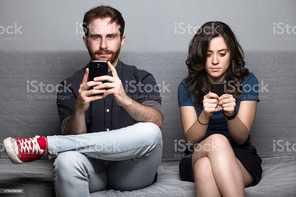 Couple with Smartphones stock photo