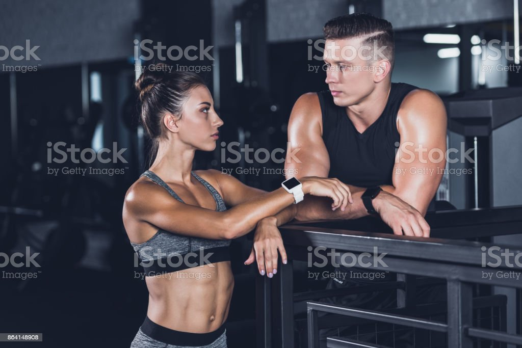 couple with smartwatches looking at each other royalty-free stock photo