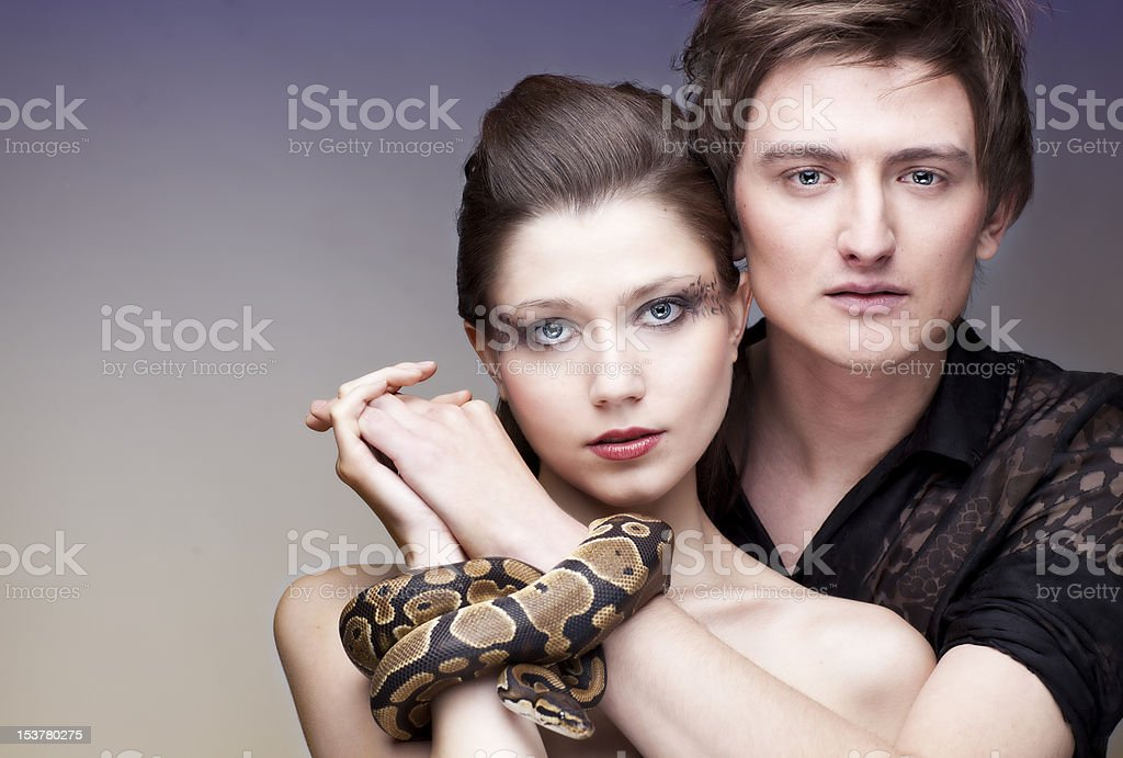 Couple with snake royalty-free stock photo