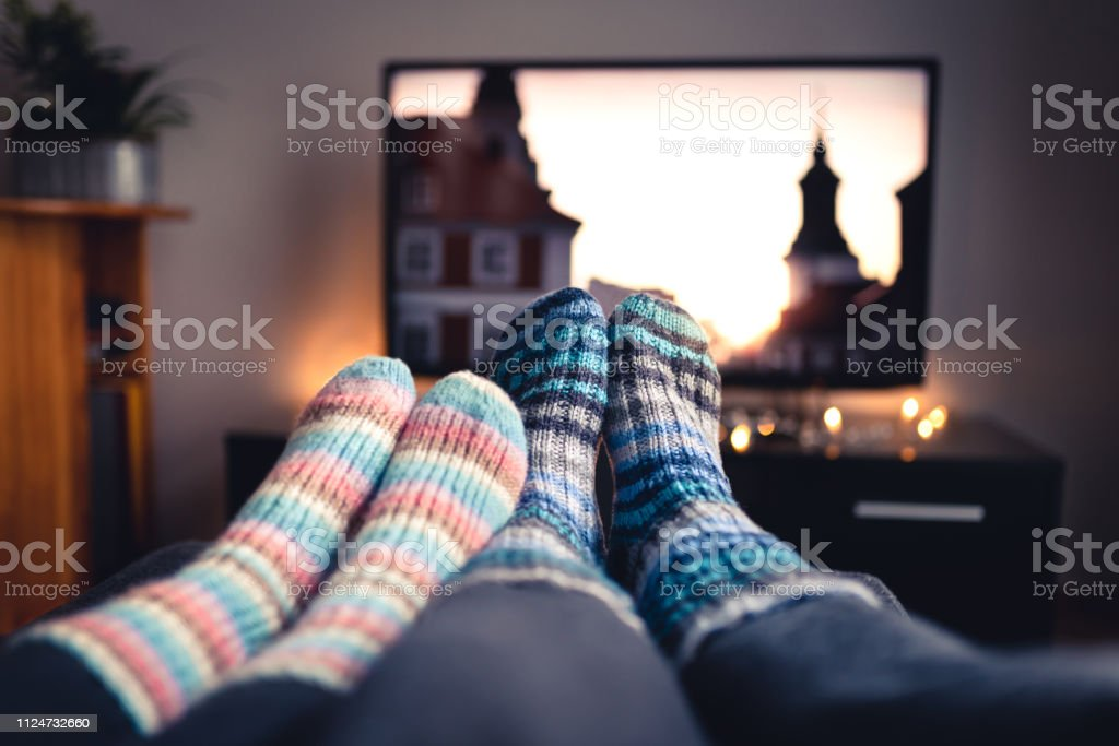 Terrific Couple With Socks And Woolen Stockings Watching Movies Or Cjindustries Chair Design For Home Cjindustriesco
