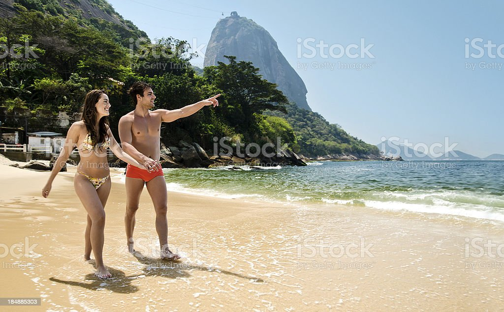 Couple with sugar loaf on background royalty-free stock photo