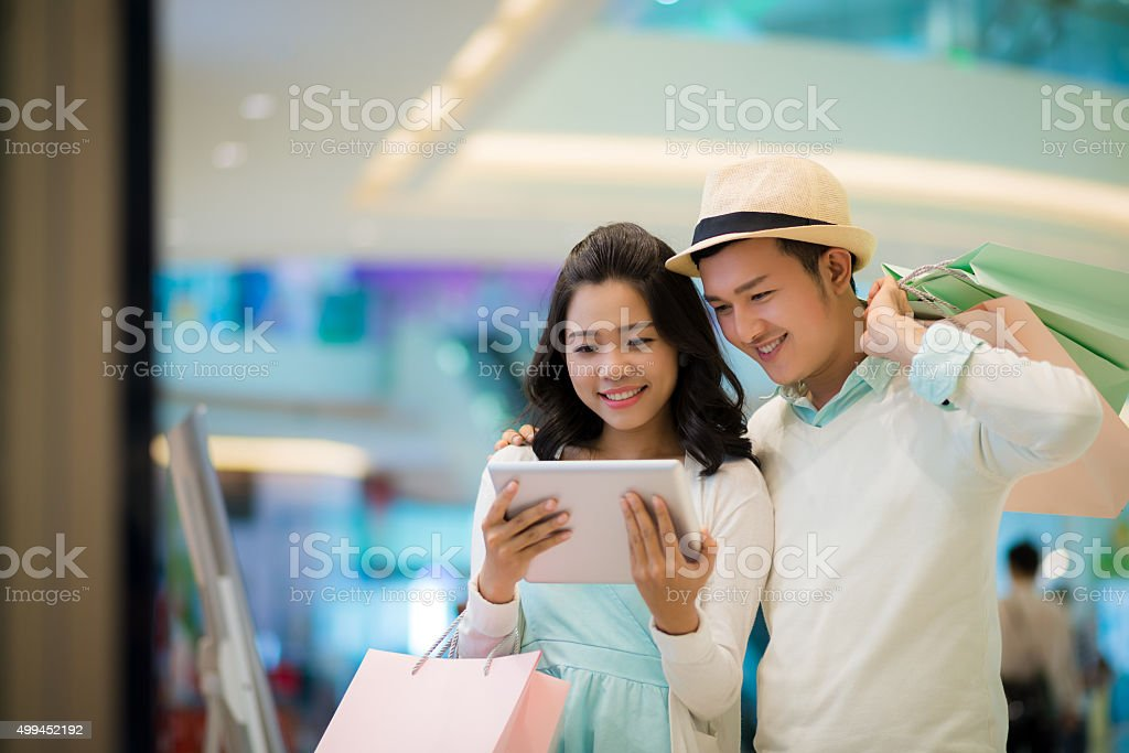 Couple with tablet stock photo