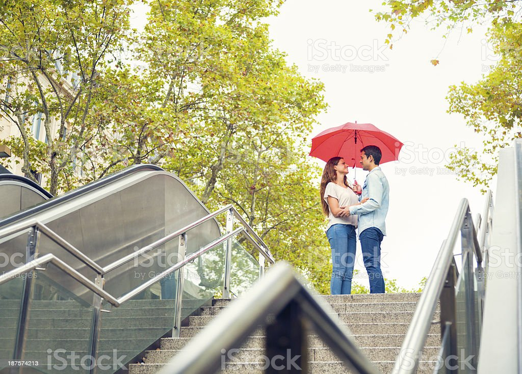 Couple with umbrella royalty-free stock photo