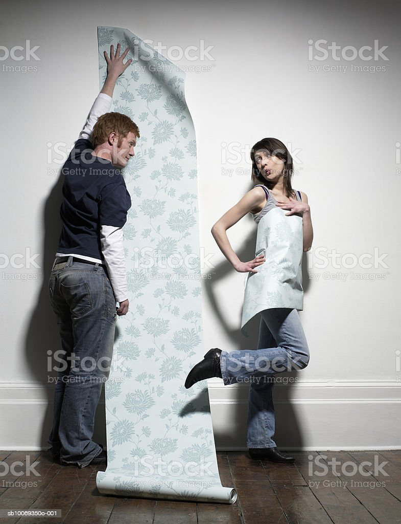 Couple with wallpaper in home royalty-free stock photo