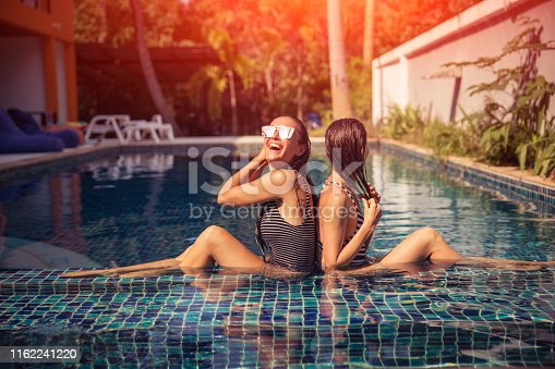 Young couple woman in the swimming pool