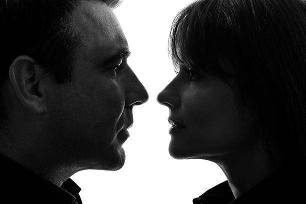 couple woman man facing each other silhouette stock photo