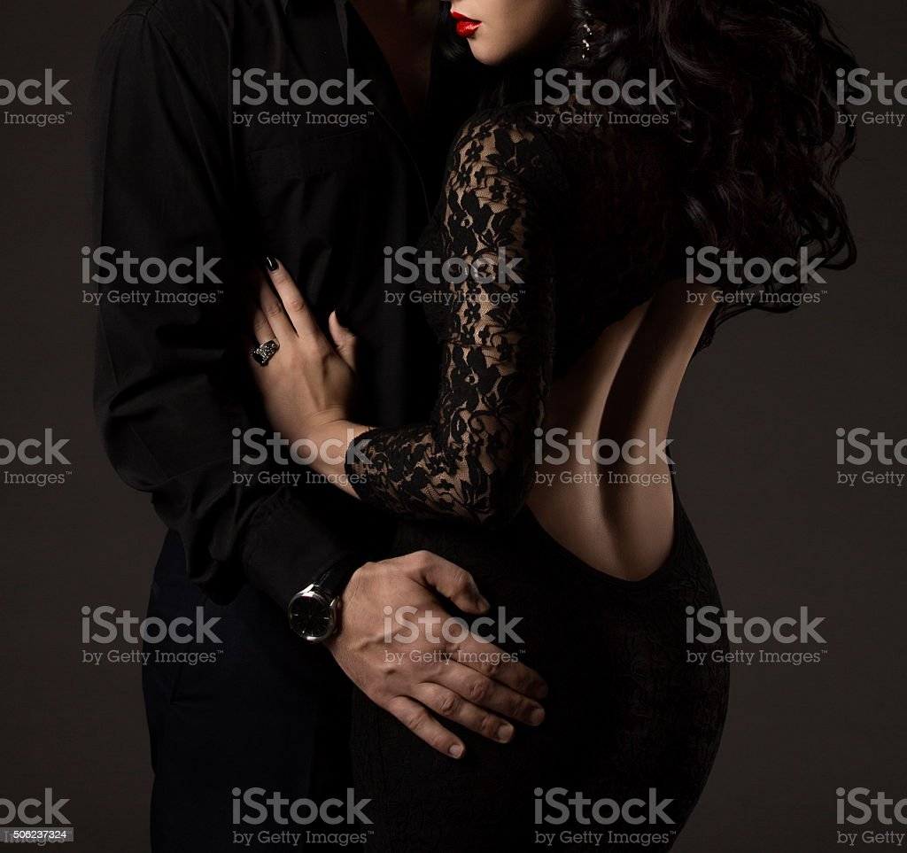 Couple Woman Man in Black, Sexy Lady Lace Dress stock photo