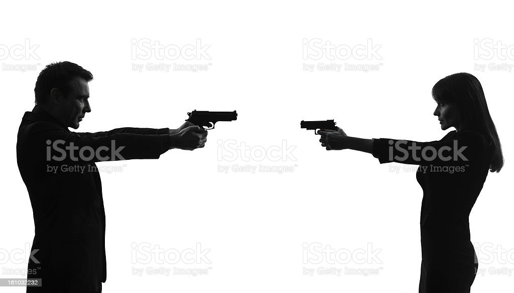 couple woman man in duel  silhouette stock photo