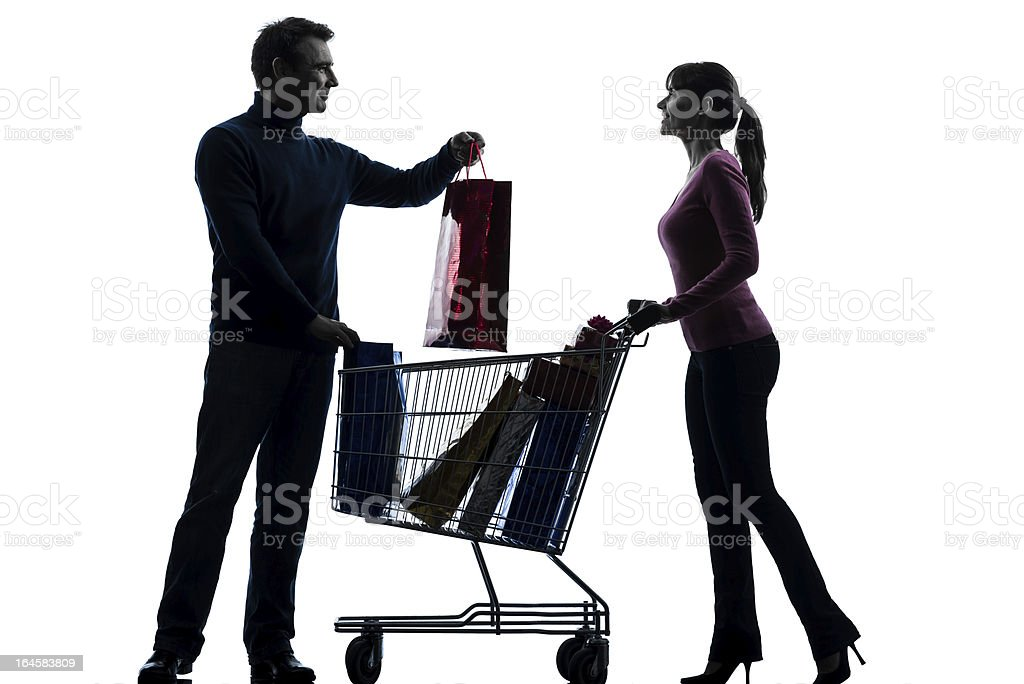 couple woman man with shopping cart and gifts silhouette royalty-free stock photo