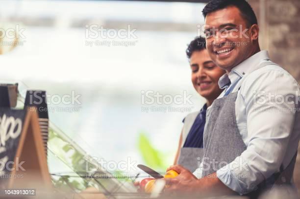 Couple working at a small retail food restaurant picture id1043913012?b=1&k=6&m=1043913012&s=612x612&h=psxmxejzw3dmoiutblzkav 0zr6hhrbcjq38dmlpu q=