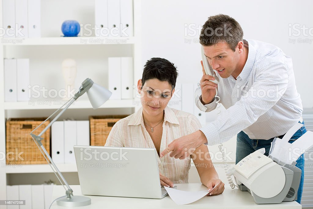 Couple working at home office royalty-free stock photo