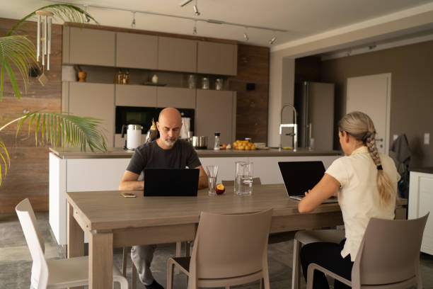 couple working from home during covid-19 quarantine stock photo