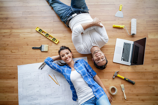istock Couple working on a housing project 646687768