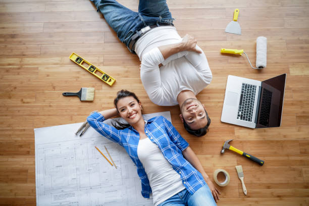 Couple working on a housing project stock photo
