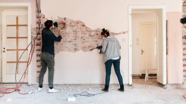Couple working on reconstruction of their apartment stock photo