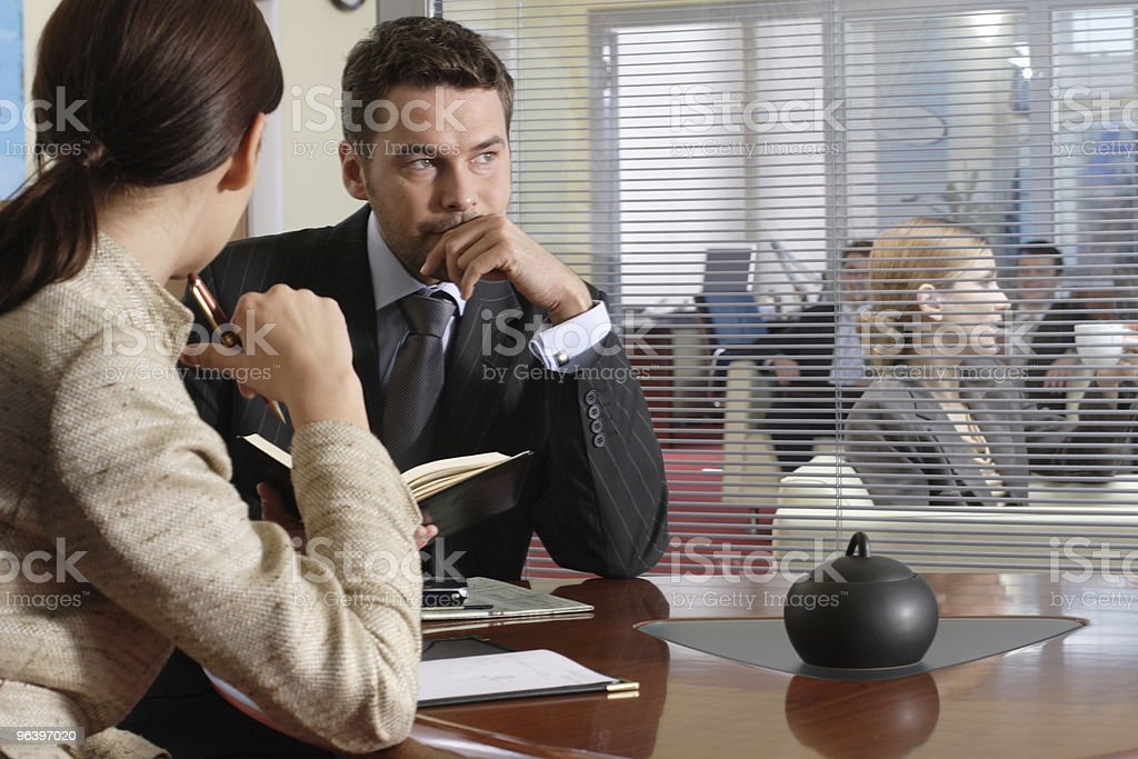 Couple working with office environment as background - Royalty-free Adult Stock Photo