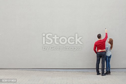 istock Couple writing on a wall 528151933