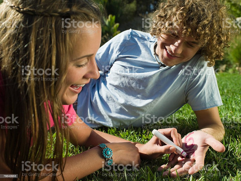 Couple writing on their hands royalty-free stock photo