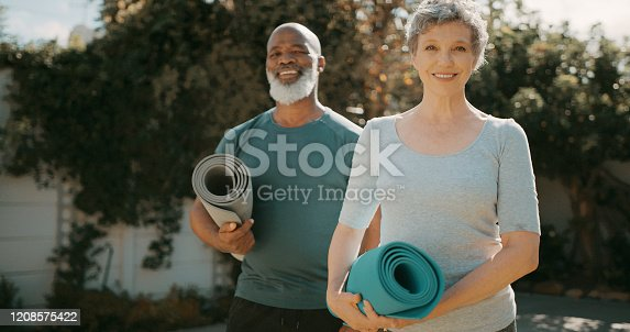 Cropped portrait of a happy senior couple standing together before a yoga session in their back garden